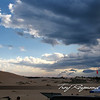 Late afternoon, a storm was rolling in, check out the cloud fish in the sky just above the dunes.