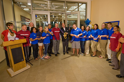 Westfield State University President Evan Dobelle (center, with scissors) cuts the ribbon at the opening of the newly renovated Dining Commons on the university campus Tuesday 9/27/2011. Also pictured are (from left) Nanci Salvidio, Ken Lemanski, Don Hummason, and Walseka Lugo-Dejesus (at far right). Also in the photo in blue shirts are members of WSU's student ambassadors.  (Note: Need to identify individual to left of Dr. Dobelle)
