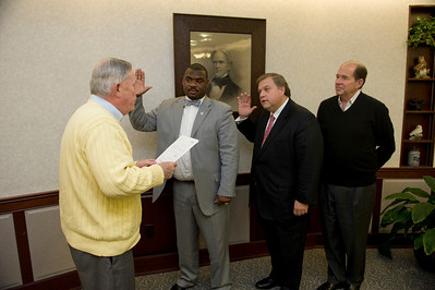 New trustees,Terrell Hill (2nd from left) and Steven P Marcus, with WSU president Evan Dobelle looking on at right, are sworn in at Westfield State University