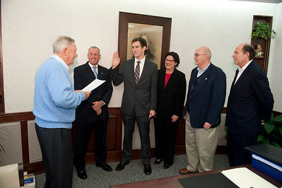 Swearing in Stone Koury, student representative to the Board of Trustees at Westfield State University