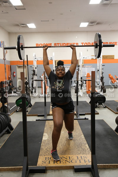 Junior Felicia Dameus prepares for the weightlifitng season by conditioning.