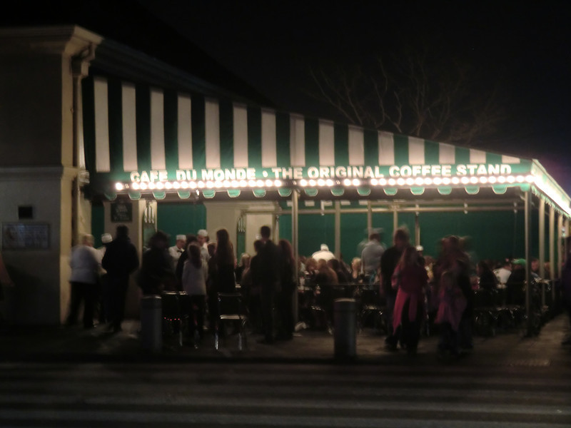 This is the world-famous Cafe Du Monde, where you can get Beignets (french donuts covered in powdered sugar).  Open 24 hours a day.