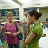 Deb chats with Lianne by the refreshment table.