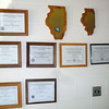 Lots of licenses and plaques.