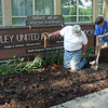 Chuck and Fran plant additional begonias that were left over.  Looks good.