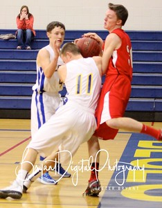 Sophomore Weston Scott (11) wrestles for the ball as Tray Asbill (4) watches during the 1st Quarter of the Bluestem JV Lions game against the Sedgwick Cardinals