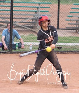 Freshman Chelsie Meyer crushes a pitch for a home run during the JV Wildcats' game against Winfield.