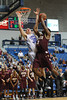Citadel Bulldogs guard/forward MATT VAN SCYOC (30) fouls Charleston Cougars forward ANTHONY THOMAS (3) as he drives to the basket in the second half of an NCAA basketball game between Charleston Cougars and the Citadel bulldogs at McAlister Field House.