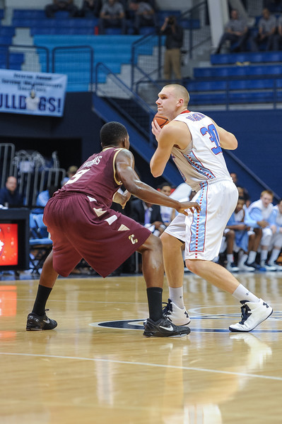 Citadel Bulldogs guard/forward MATT VAN SCYOC (30) guarded by Charleston Cougars forward ANTHONY THOMAS (3) in the first half of an NCAA basketball game between Charleston Cougars and the Citadel bulldogs at McAlister Field House.