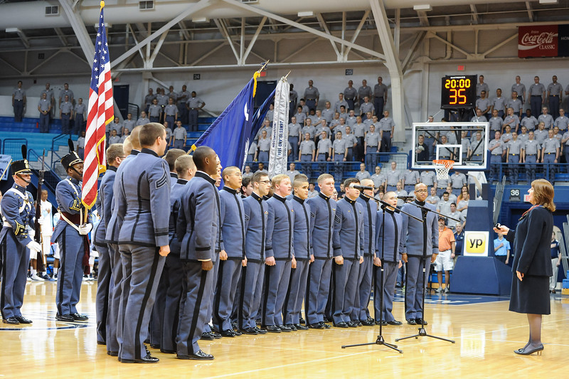 Citadel Cadets sing the National Anthem prior to an NCAA basketball game between Charleston Cougars and the Citadel bulldogs at McAlister Field House.