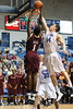 Charleston Cougars forward/center ADDJEHI BARU (1) goes for the dunk as Citadel Bulldogs forward P.J. HORGAN (44) tries to block the attempt in the second half of an NCAA basketball game between Charleston Cougars and the Citadel bulldogs at McAlister Field House.