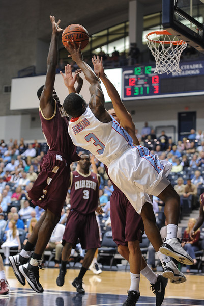 Citadel Bulldogs guard JANEIL JENKINS (3) drives to the basket while two Cougar defender tries to block the shot in the first half of an NCAA basketball game between Charleston Cougars and the Citadel bulldogs at McAlister Field House.