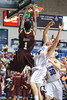 Charleston Cougars forward/center ADDJEHI BARU (1) dunks while be challenged by Citadel Bulldogs forward P.J. HORGAN (44) in the second half of an NCAA basketball game between Charleston Cougars and the Citadel bulldogs at McAlister Field House.