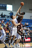 Charleston Cougars forward/center ADDJEHI BARU (1) makes a shot while be guarded by Citadel Bulldogs forward P.J. HORGAN (44) in the second half of an NCAA basketball game between Charleston Cougars and the Citadel bulldogs at McAlister Field House.