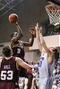 Citadel Bulldogs center MIKE GROSELLE (31) tries to block the shot of Charleston Cougars forward ANTHONY THOMAS (3) in the second half of an NCAA basketball game between Charleston Cougars and the Citadel bulldogs at McAlister Field House.