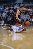 Citadel Bulldogs guard MARSHALL HARRIS III (10) makes a pass from the floor while being defended by Charleston Cougars guard ANDREW LAWRENCE (4) in the first half of an NCAA basketball game between Charleston Cougars and the Citadel bulldogs at McAlister Field House.
