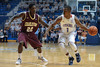 Citadel Bulldogs guard/forward RAEMOND ROBINSON (1) looks for an opening against Charleston Cougars guard ANTHONY STITT (22) in the first half of an NCAA basketball game between Charleston Cougars and the Citadel bulldogs at McAlister Field House.