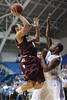 Charleston Cougars guard ANDREW LAWRENCE (4) shoots against a Citadel defender in the second half of an NCAA basketball game between Charleston Cougars and the Citadel bulldogs at McAlister Field House.