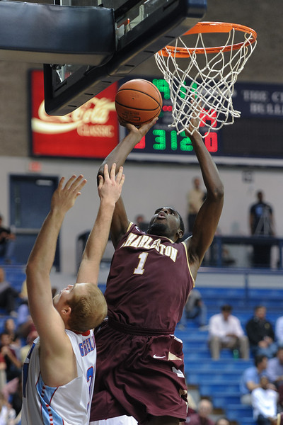 Charleston Cougars forward/center ADDJEHI BARU (1) shoots over Citadel Bulldogs center MIKE GROSELLE (31) in the second half of an NCAA basketball game between Charleston Cougars and the Citadel bulldogs at McAlister Field House.