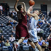 Citadel Bulldogs guard/forward MATT VAN SCYOC (30) is fouled by Elon Phoenix forward RYAN WINTERS (32) as he attempts a shot in an NCAA basketball game between Elon Phoenix and the Citadel Bulldogs at McAlister Field House.  Elon defeated the Citadel 70-66.