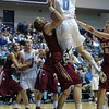 Citadel Bulldogs guard/forward DYLEN SETZEKORN (0) drives to the basket and an Elon player is called for a block in an NCAA basketball game between Elon Phoenix and the Citadel Bulldogs at McAlister Field House.  Elon defeated the Citadel 70-66.