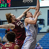 Elon Phoenix forward RYLEY BEAUMONT (21)fouls Citadel Bulldogs forward P.J. HORGAN (44) as he attempts a shot in an NCAA basketball game between Elon Phoenix and the Citadel Bulldogs at McAlister Field House.  Elon defeated the Citadel 70-66.