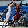 Citadel Bulldogs forward P.J. HORGAN (44) tries to block a shot against Elon in an NCAA basketball game between Elon Phoenix and the Citadel Bulldogs at McAlister Field House.  Elon defeated the Citadel 70-66.