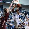 Citadel Bulldogs guard MARSHALL HARRIS III (10) is fouled as he drives to the basket in an NCAA basketball game between Elon Phoenix and the Citadel Bulldogs at McAlister Field House.  Elon defeated the Citadel 70-66.