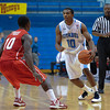 Citadel Bulldogs guard Marshall Harris III (10) brings the ball up the court against Radford Highlanders guard R.J. Price (10) in an NCAA basketball game at McAlister Field House.