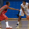 Citadel Bulldogs guard Marshall Harris III (10) guarded by Radford Highlanders guard Rashun Davis (5) in an NCAA basketball game at McAlister Field House.