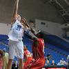 Citadel Bulldogs center Mike Groselle (31) takes a shot over Radford Highlanders guard Taj Owens (1) in an NCAA basketball game at McAlister Field House.