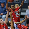 Radford Highlanders guard Blake Smith (25) goes up to make a block on Citadel Bulldogs guard Lawrence Miller (24) in an NCAA basketball game at McAlister Field House.