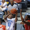 Citadel Bulldogs guard Ashton Moore (12) goes up for a lay up against a Radford defended in an NCAA basketball game at McAlister Field House.