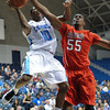 Radford Highlanders forward Brandon Holcomb (55) goes for the block against Citadel Bulldogs guard Marshall Harris III (10) in an NCAA basketball game at McAlister Field House.
