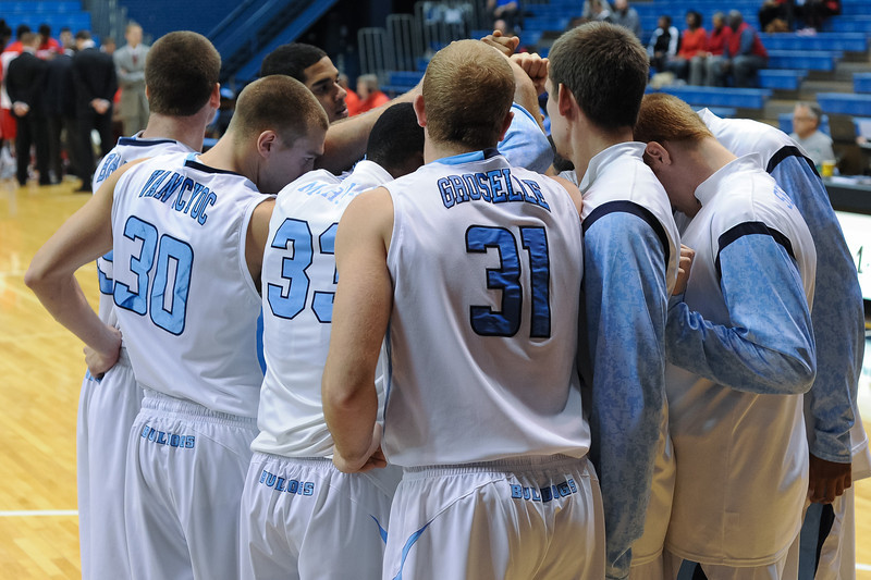 (L to R) Citadel players Matt Van Scyoc (30), Quinton Marshall (33), and Mike Groselle  (31) break the huddle prior to tip off  in an NCAA basketball game against the Radford Highlanders at McAlister Field House.