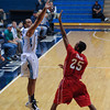 Citadel Bulldogs guard Lawrence Miller (24) shots over Radford Highlanders guard Blake Smith (25) in an NCAA basketball game at McAlister Field House.