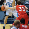 Citadel Bulldogs guard/forward Matt Van Scyoc (30) guarded by Radford Highlanders guard Kyle Noreen (33) in an NCAA basketball game against the Radford Highlanders at McAlister Field House.