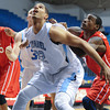 Citadel Bulldogs forward Stephen Elmore (22) blocks out a Radford player in an NCAA basketball game at McAlister Field House.
