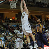 Charleston Cougars forward TRENT WIEDEMAN (44) dunks the ball as UNC-Greensboro Spartans players look on in an NCAA basketball game between UNCG Spartans and the College of Charleston Cougars, Saturday Feb 2, 2013 at TD Arena. (Shane Roper/Special to The Post and Courier)