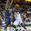 Charleston Cougars forward/center ADJEHI BARU (1) pump fakes UNC-Greensboro Spartans forward KAYEL LOCKE (13) in an NCAA basketball game between UNCG Spartans and the College of Charleston Cougars, Saturday Feb 2, 2013 at TD Arena. (Shane Roper/Special to The Post and Courier)