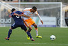 Houston Dynamo midfielder Ricardo Clark (13) gets held by Chicago Fire forward Dilly Duka (8) during an MLS exhibition between the Chicago Fire and the Houston Dynamo during opening night of the Carolina Challenge Cup at Blackbaud Stadium.