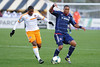 Chicago Fire forward Sherjill MacDonald (7) dribbles the ball with Houston Dynamo defender Jermaine Taylor (4) defending during an MLS exhibition between the Chicago Fire and the Houston Dynamo during opening night of the Carolina Challenge Cup at Blackbaud Stadium.