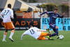 Houston Dynamo midfielder Ricardo Clark (13) slides to try to deflect the ball against Chicago Fire defender Gonzalo Segares (13) during an MLS exhibition between the Chicago Fire and the Houston Dynamo during opening night of the Carolina Challenge Cup at Blackbaud Stadium.