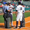 Hickory Crawdads manager Corey Ragsdale (24),Charleston RiverDogs coach Justin Tordi (24)