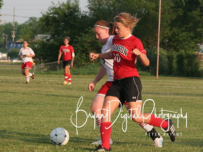 Senior Ashley Smith battles a member of the Branson Lady Pirates for possession of the ball in the first half of their soccer match.