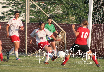 Suzee Tullos (15) clears the ball from in front of the Zizzers goal as Mary Jones (9) and Jada Hansmann look on.