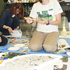Students at the Northeast Regional Youth Summit making a collage in the shape of a Peace Dove using torn magazines and newspaper. The final piece of artwork is being donated to the Battery Park City School. (c) JGI/Adrienne Bermingham