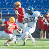 Loyola Blakefield senior and captain Alex Hunt (32) avoids contact with Nicholas Smith (6), junior at Calvert Hall.