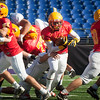 Calvert Hall senior Garrett Keene (7) breaks through a hole in the defensive line during the 93rd annual Turkey Bowl.
