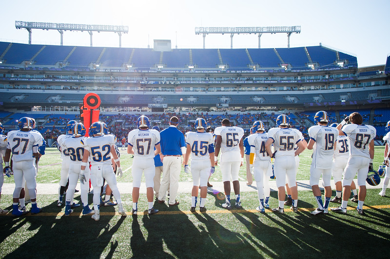 Loyola Blakefield players wait on the sideline before taking the field for the 93rd annual Turkey Bowl.
